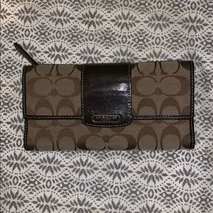 Gently used trifold brown Coach wallet